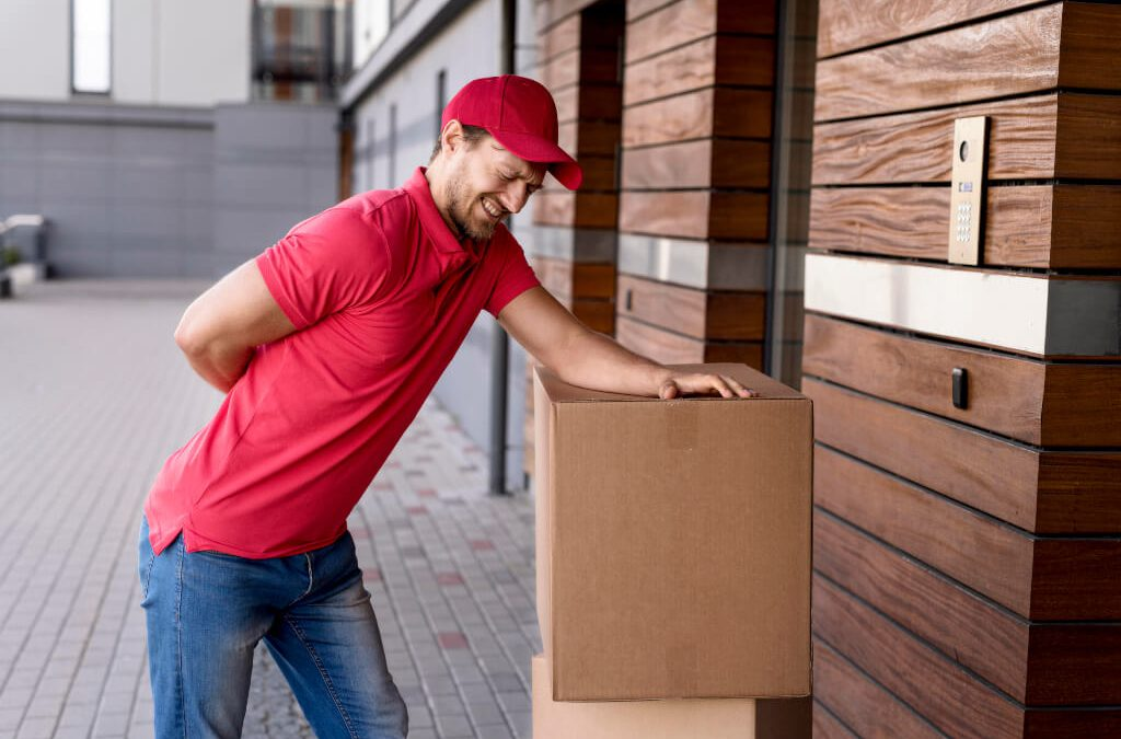 Delivery man having back pain due to a manual handling injury